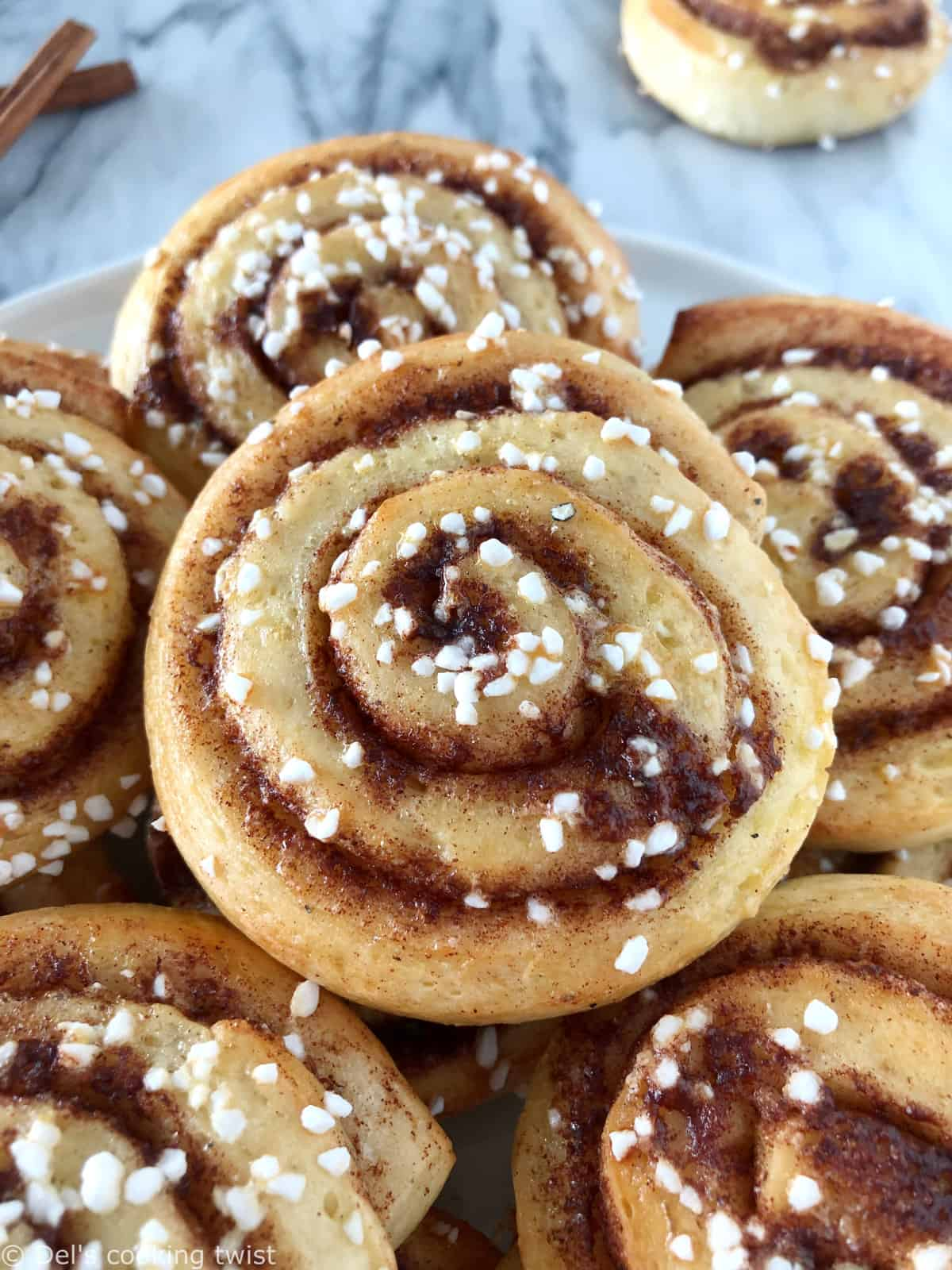 """The authentic Swedish cinnamon rolls """"kanelbullar"""". The recipe is extremely easy and comes with a step-by-step tutorial to guide you."""