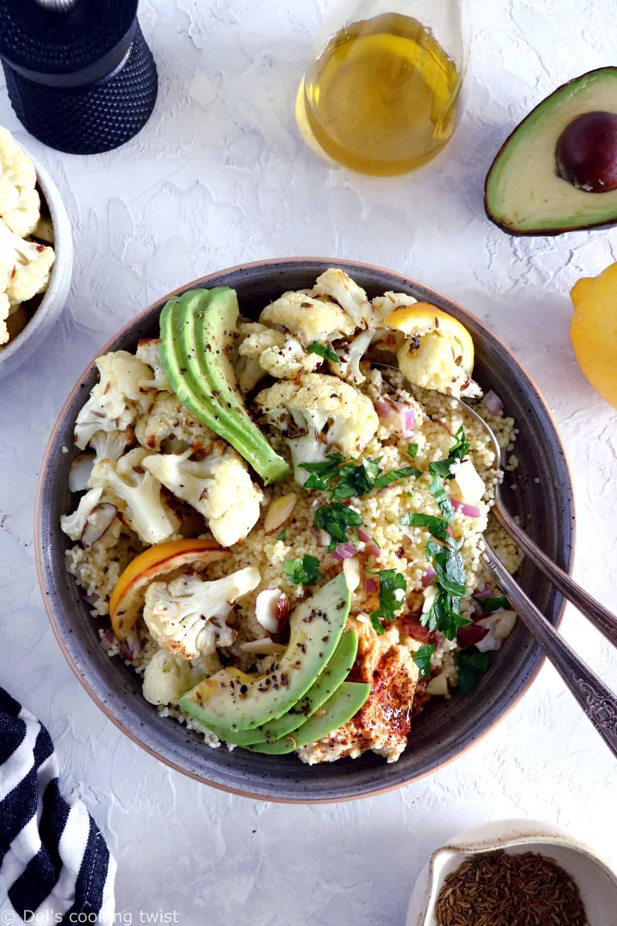 This quick and easy cumin-roasted cauliflower tabbouleh salad is game-changing. It's a super healthy vegan salad recipe, packed with delicious roasted veggies, fresh herbs, and loaded with plant-based protein.