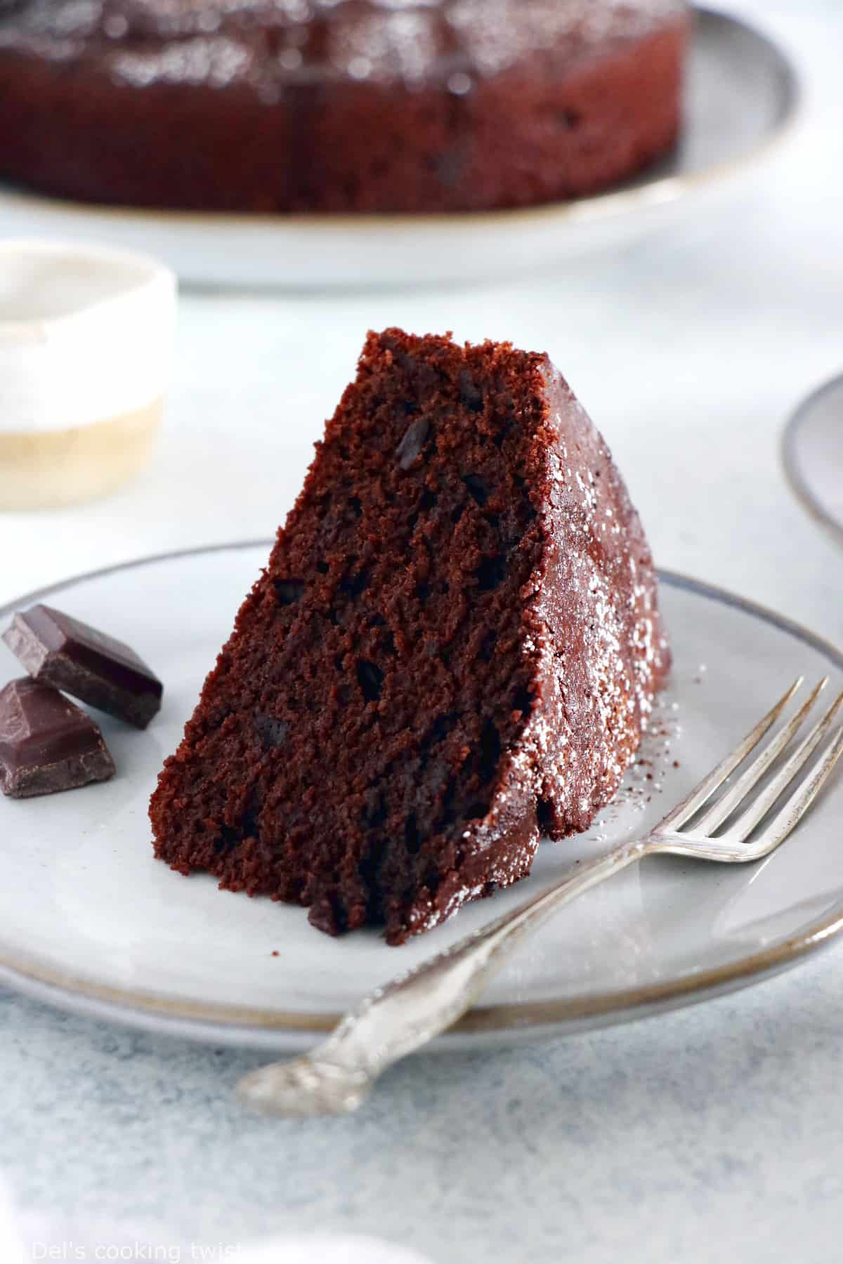 You'll love this Easy Chocolate Olive Oil Yogurt Cake. Directly inspired from the classic French Yogurt Cake, this no-fail recipe is moist, tender, and deliciously chocolaty.