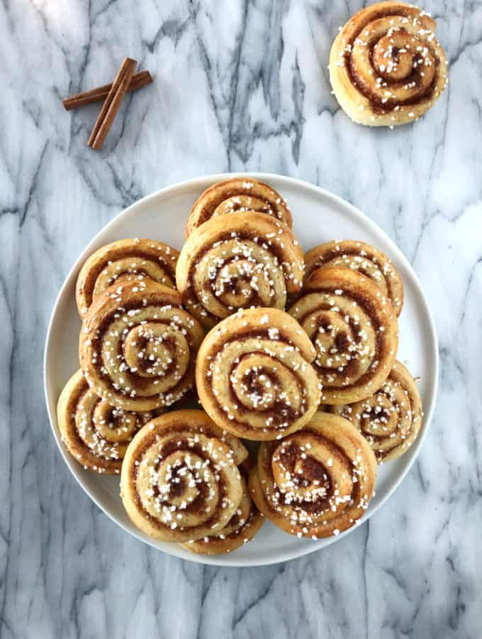 "The authentic Swedish cinnamon rolls ""kanelbullar"". The recipe is extremely easy and comes with a step-by-step tutorial to guide you."