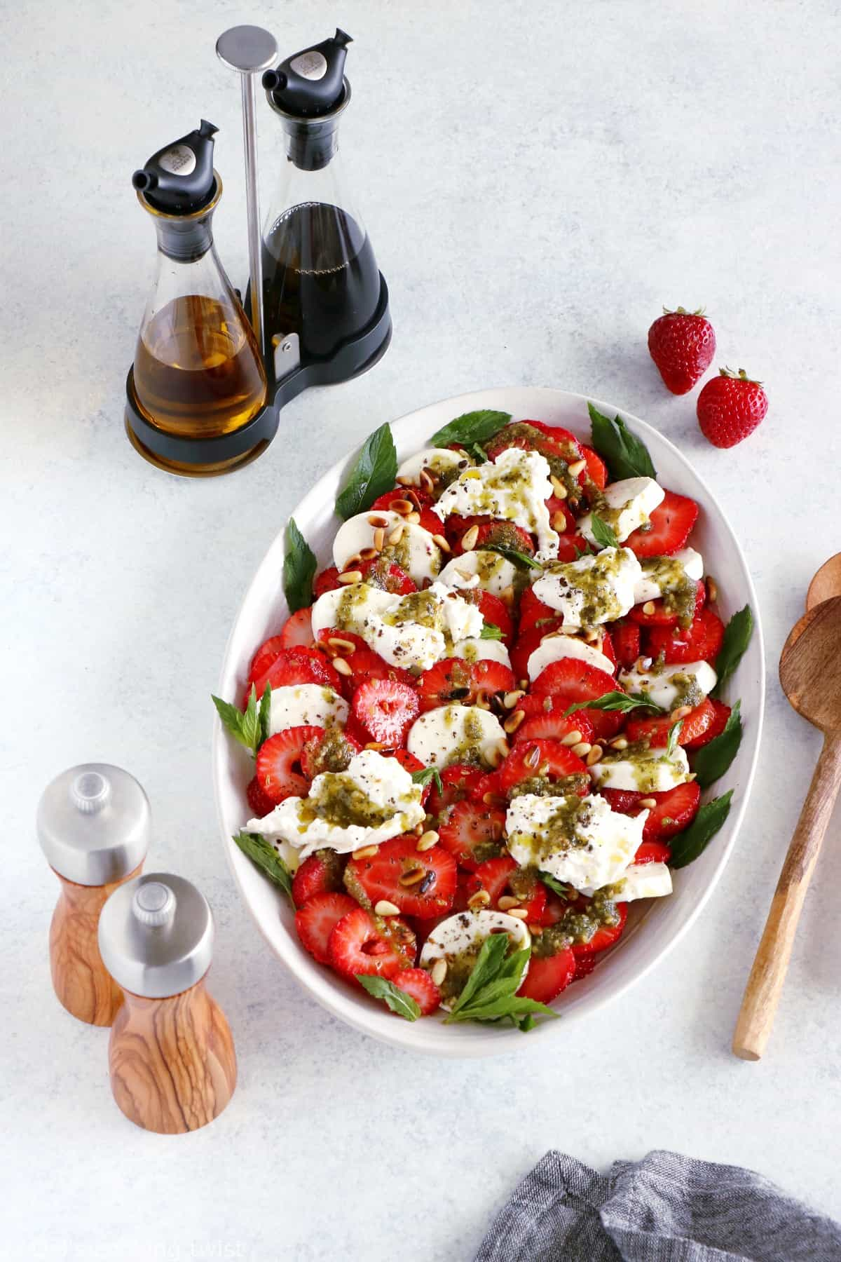 Strawberry Burrata Salad with Mint Pesto. This simple strawberry burrata salad with a mint pesto is full of summer goodness. It is loaded with refreshing flavors with juicy, creamy and crunchy textures. The salad is also naturally gluten-free and ready in no time!