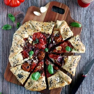 Balsamic Caramelized Onions and Goat Cheese Tomato Galette. This tomato galette is prepared with balsamic caramelized onions, heirloom tomatoes and fresh goat cheese, all tucked into a flaky pie crust. It makes a great end of summer light dinner, appetizer or brunch item.