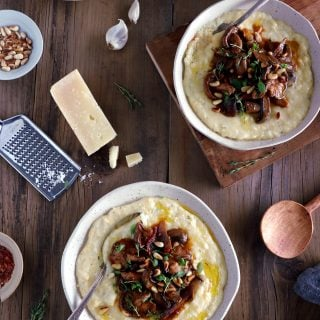 Parmesan polenta with thyme mushroom ragu makes a hearty plant-based dinner recipe for those chilly days. Enjoy with a glass of wine!