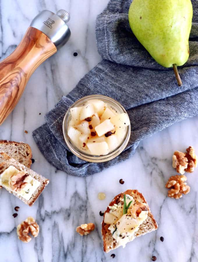 This easy pear compote with black peppercorn and vanilla syrup will be perfect as an appetizer on your cheese board for your next gathering party!
