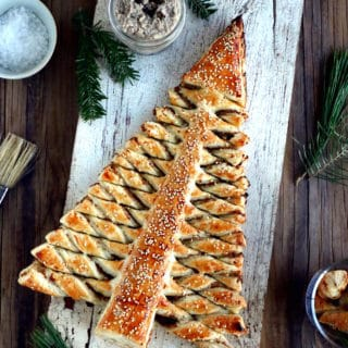 Puff pastry Christmas tree is a festive holiday appetizer with pull-apart breadsticks filled with savory toppings of your choice. Easy to make and delicious, it is sure to impress at your next Christmas party!