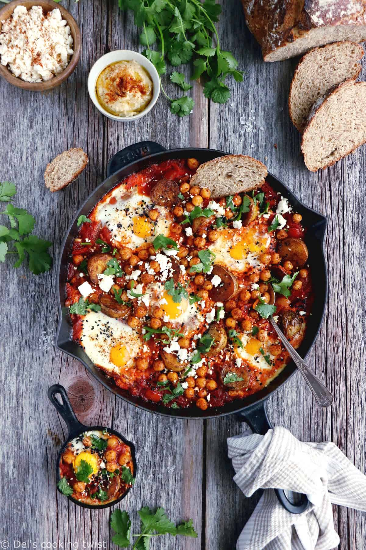 Take the shakshuka to the next level with this deluxe shakshuka recipe, featuring the classic baked eggs and tomatoes with an extra kick of spicy roasted potatoes and chickpeas.