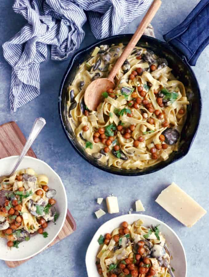 This quick everyday pasta dish features a deliciously creamy mushroom sauce and some crispy spiced chickpeas. An easy family-friendly vegetarian meal everyone loves!