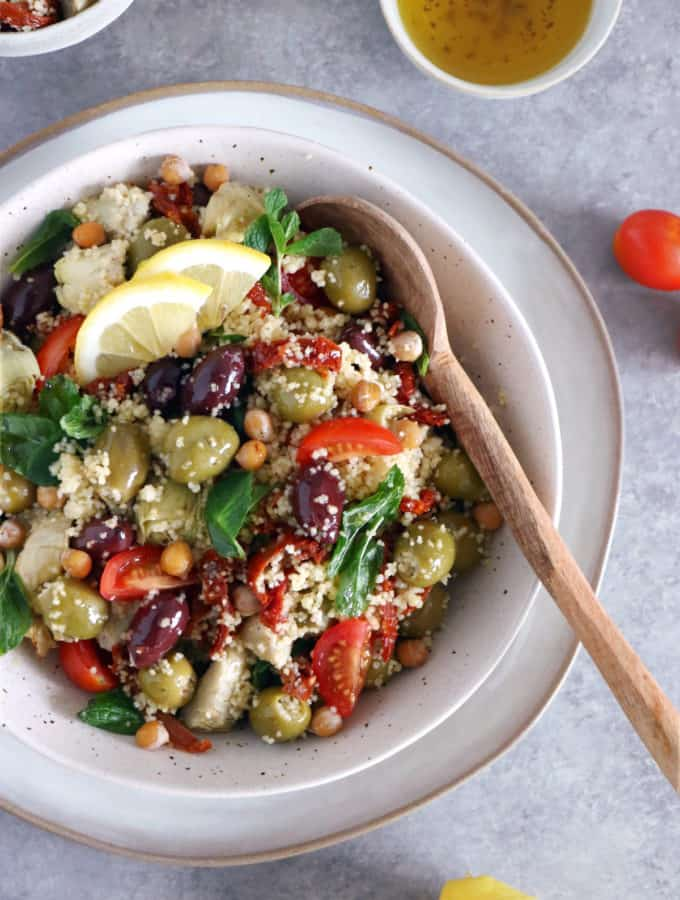 Add some sun to your plate with this easy Mediterranean couscous salad with chickpeas, olives and artichoke hearts.