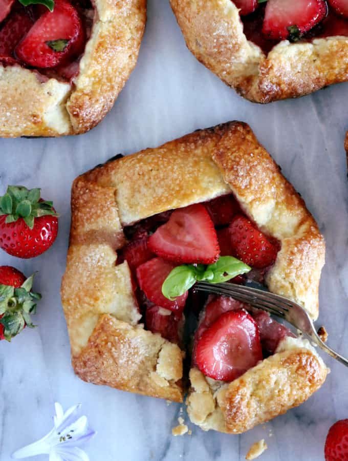 These mini balsamic strawberry galettes are packed with juicy, sweet and sour flavors, all wrapped up in a flaky buttery crust.