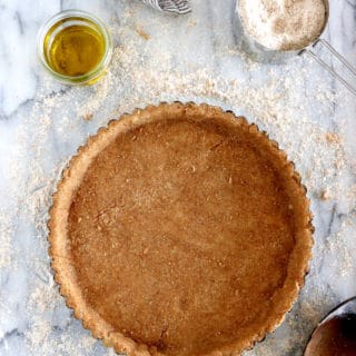This Olive Oil Whole Wheat Pie Crust is a 100% vegan pie crust and a perfect alternative to a classic butter pie crust.