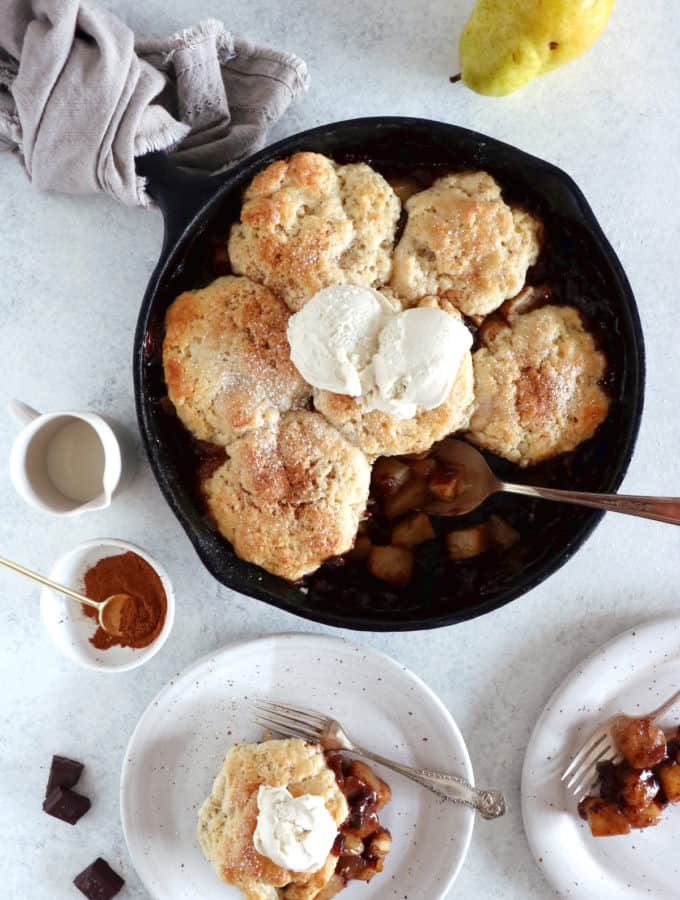 Spiced Chocolate Pear Cobbler is a beautiful dessert featuring dropped biscuit and seasonal fruits coated with a mix of warm Autumn spices and dark chocolate.