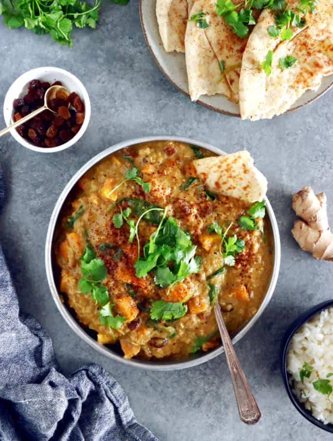 This Vegan Indian Mango Butternut Squash Curry features a creamy mango curry sauce, diced butternut squash, all wrapped in some delicious warm spices.