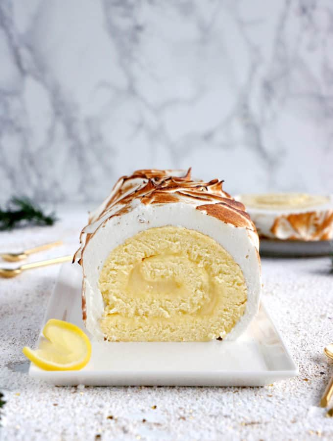 Lemon Meringue Roulade or cake roll consists of a supremely moist sponge cake filled with homemade lemon curd and covered with swirls of torched meringue.