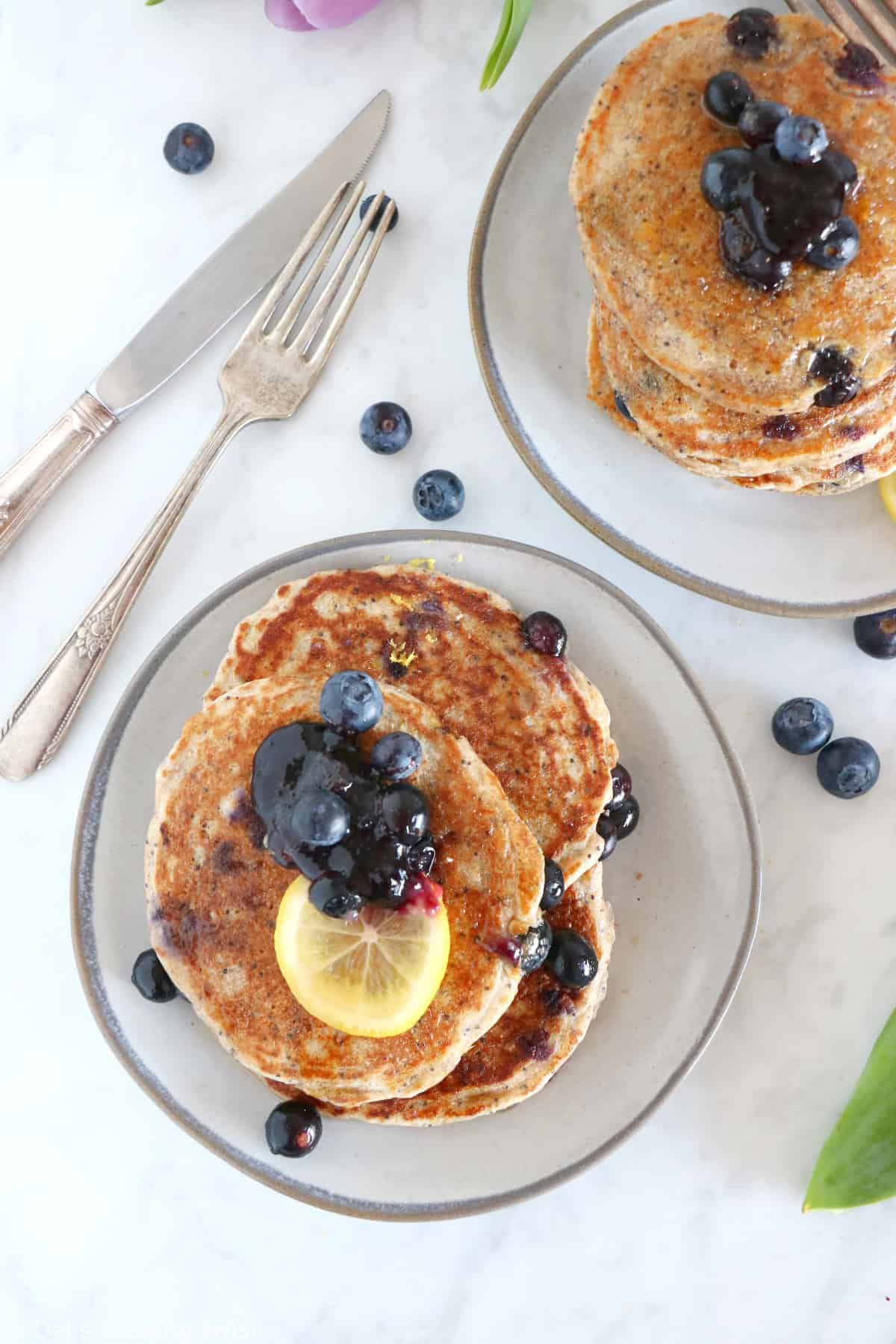 These lemon poppy seed blueberry pancakes are sugar-free, packed with fruits and prepared with whole-wheat flour.