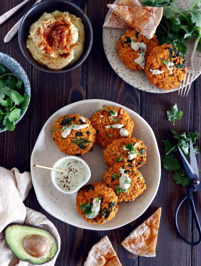 Easy and delicious red lentil patties served with a garlic-herb tahini sauce. Both vegan and gluten-free, these veggie patties are bursting with savory flavors, hearty texture, and oodles of plant-based protein.