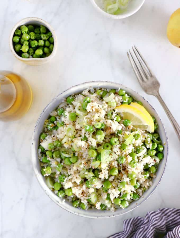 Learn how to make healthy cauliflower rice with peas in no time. This super easy side recipe is a great substitute for rice and the perfect way to sneak in more veggies into your diet.