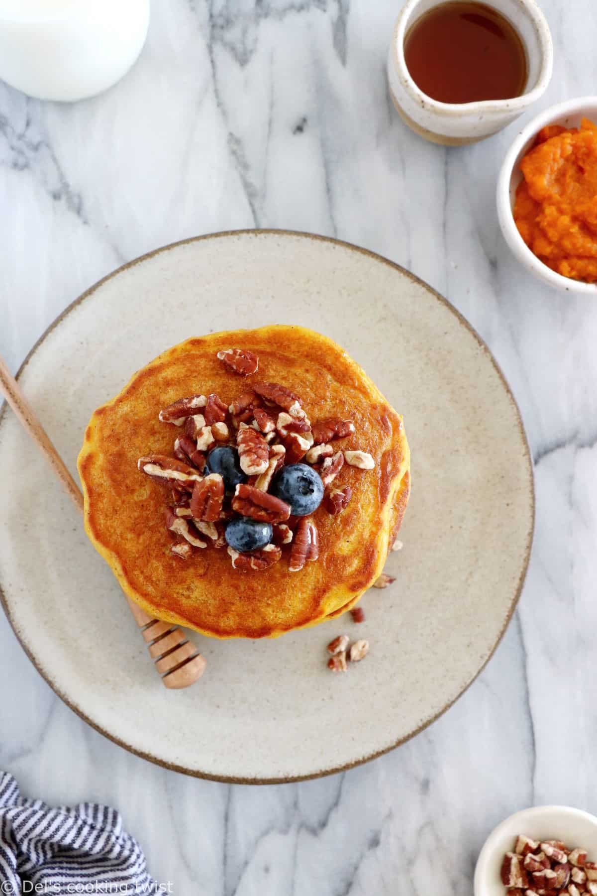Perfect pumpkin pancakes are fluffy, moist and generous, and prepared with real pumpkin puree and warm pumpkin pie spices.